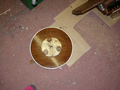 The underside of the mirror platter showing pads which fit holes in the pulley wheel